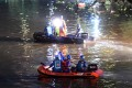 Rescuers search the site of the boat accident on the Taohua River in Guilin on Saturday. Photo: Xinhua
