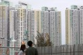 A young couple looks out over residential buildings in Kai Tak early this month. Photo: SCMP