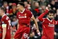 Mohamed Salah (right) refuses to celebrate after opening the scoring for Liverpool against his former club Roma. Photo: Reuters