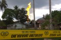 A fire that killed at least 10 people burns at an oil well in Peureulak in Indonesia's Aceh province on Tuesday. Photo: Agence France-Presse