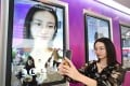 A staff member of Meitu demonstrates the company's software product. Photo: Xinhua