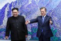 South Korean President Moon Jae-in (right) and North Korean leader Kim Jong-un before their summit meeting in the demilitarised zone, in the South's border village of Panmunjom, on April 27. The summit marked the first time a North Korean leader had crossed into the South since the end of hostilities during the Korean war, and set the stage for Kim's meeting with the US president. Photo: EPA-EFE