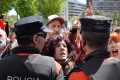 Protesters press up against police after five men accused of the gang rape of a woman during the 2016 San Fermin festival were found guilty of the lesser offence of sexual abuse. Photo: Reuters