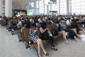 Travellers wait at the new Guangzhou airport terminal on its first day of operation on Thursday. Photo: Edward Wong