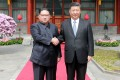Kim Jong-un (left) travelled to Beijing to meet Xi Jinping last month and Xi reportedly plans to visit Pyongyang, possibly in June. Photo: AFP / KCNA via KNS