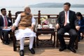 Narendra Modi (left) talks with Xi Jinping by the scenic East Lake in Wuhan on Saturday. Photo: AFP
