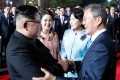 Kim Jong-un (left) and Moon Jae-in say farewell during the closing ceremony of the inter-Korean summit in Panmunjom on Friday. Photo: AFP