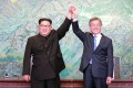 North Korea's leader Kim Jong-un and South Korea's President Moon Jae-in posing during a signing ceremony near the end of their historic summit. Photo: AFP