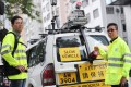 Land surveyors, Ng Wai-wang (left) and Eddie Ho with the vehicle used to map out Hong Kong's roads. Photo: Winson Wong