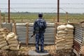A Myanmar border guard near the Taung Pyo Letwe camp overlooking the border with Bangladesh. Photo: Reuters