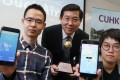 (left to right): Sun Peifeng, Professor Huang Bo and Tong Xuelian with their award winning, real-time air quality mobile app. Photo: K.Y. Cheng