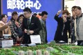 Sales staff and potential buyers at a property fair in China. Developers are less optimistic about sales growth this year as government curbs and higher mortgage rates bite. Photo: Reuters