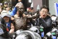 Labour group members clash with police officers near the Japanese Consulate General in Busan, South Korea, on Tuesday, over the installation of a statue symbolising Korean workers forcibly taken to Japan during its 1910-1945 colonial rule. Photo: Kyodo