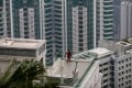 A woman exercises on the terrace of one of seven luxury units situated at 28 Barker Road, an exclusive residential area of The Peak, in Hong Kong. Photo: EPA-EFE