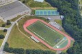 Holmdell High School's track and football field (pictured) have been afflicted by human faeces on several occasions. On Monday April 30, police charged the school's superintendent with befouling the property. Picture: Google Earth