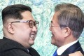 South Korean President Moon Jae-in (right) and North Korean leader Kim Jong-un,during their historic meeting at the border village of Panmunjom. Photo: Kyodo