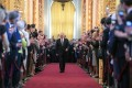 Russian President Vladimir Putin walk into his inauguration ceremony at the Kremlin in Moscow on May 7. Photo: AFP