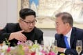 This picture taken on April 27, 2018 and released from North Korea's official Korean Central News Agency (KCNA) on April 29, 2018 shows North Korea's leader Kim Jong Un (L) and South Korea's President Moon Jae-in (R) speaking during the official dinner at the end of their historic summit at the truce village of Panmunjom. Photo:AFP/KCNA VIA KNS/STR/ - South Korea