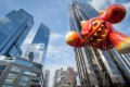 The Macy's Thanksgiving Day Parade moves through Columbus Circle in New York. Deutsche Bank's new Midtown address will be One Columbus Circle, which is part of the complex at the 80-story, twin-towered Time Warner Center. Photo: AP