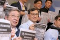 """Aaron Shum (centre) called the plan to scrap the MPF's offsetting mechanism """"unfair"""". Photo: Dickson Lee"""