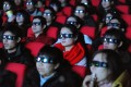 Chinese cinemagoers watch the 3D science-fiction blockbusterAvatarinHefei, Anhui province, in January 2010. Hollywood films a decade ago contributed over 50 per cent to China's box-office revenue, but they have been upstaged by domestic films and other Asian productions. Photo: AFP
