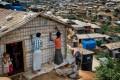 Rohingya refugees rebuild their makeshift house, in preparation for the approaching monsoon season at the Kutupalong Rohingya refugee camp in Kutupalong, Bangladesh on April 28. Photo: AP
