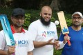 Razaq Ehtsham (left), Malik (centre), and Numan, get ready for a game of cricket at the Muslim Council of Hong Kong Youth Club. Photo: Winson Wong