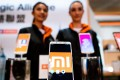 Xiaomi smartphones stand on display during a news conference in Hong Kong on May 3, 2018. The Chinese technology start-up is seeking to invalidate certain patent rights that it allegedly infringed in a lawsuit filed by a unit of rival smartphone maker Coolpad Group. Photo: Bloomberg