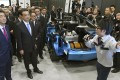 China's premier, Li Keqiang (second from left), and Japan's prime minister, Shinzo Abe (left), visit a Toyota factory in Tomakomai on Japan's northernmost main island of Hokkaido. Photo:Kyodo