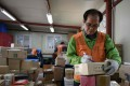 Working pensioner Park Jae-yeol, 71, sorts his packages before delivering them in Seoul, South Korea. Photo: AFP