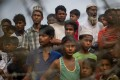 Rohingya refugees near the border with Bangladesh. The crisis has displaced around 700,000 people. Photo: AFP