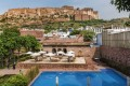 The Raas hotel in Jodhpur, India's 'Blue City', with the imposing clifftop Mehrangarh Fort in the background.