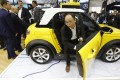 An attendee gets off from an autonomous electric car from BAIC during the China Auto 2018 show in Beijing in April this year. In the same month, China issued draft guidelines on road testing autonomous vehicles and is reviewing a final version. The technology behind self-driving cars is considered critical to the government's plan to elevate the nation's standing in the global auto industry. Photo: AP