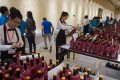 Waiters take wine bottles to be tested by expert judges during the 2018 Concours Mondiale de Bruxelles at a luxury hotel in Beijing on May 11. Photo: AFP
