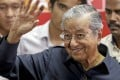 Malaysian Prime Minister Mahathir Mohamad waves at the end of a press conference in Kuala Lumpur. Photo: EPA