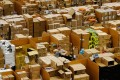 A worker picks an item for a customer's order at an Amazon.com fulfilment centre in Britain. Amazon wants to evolve from an e-commerce provider into a global logistics operation, helping merchants on its online platform connect directly with manufacturers in China. Photo: Bloomberg