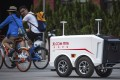 JD.com shows is working with major lift manufacturers to provide machine-to-machine communications between its courier robots and lifts to help complete deliveries inside buildings. Photo: AP