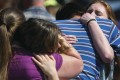 Parents greet and hug their children after a shooting at Dixon High School on Wednesday in Dixon, Illinois. Photo: Sauk Valley Media via AP