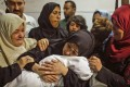 A Palestinian mother weeps for her child who died of tear-gas inhalation during clashes in East Gaza, at a hospital morgue in Gaza City on May 15. Photo: AFP