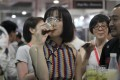 A woman drinks beer at the 2018 Craft Beer of China Exhibition in Shanghai, an event dedicated to expanding the palette of local consumers and promoting the sale of high-end brews. Photo: AP