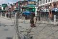 Indian paramilitary members stand guard near a temporary barricade in Srinagar. Photo: EPA
