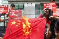 Philippine strongman finds himself between a rock and a hard place as Beijing refuses to let up on militarising areas it claims in the South China Sea