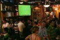 Football fans watch a match in a bar in Wan Chai, Hong Kong. Photo: SCMP