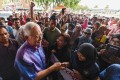 Najib shakes hands with supporters during an event in Pekan on May 20, 2018. Photo: AFP
