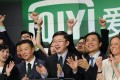 Yu Gong (center), Founder and CEO of China-based iQiyi, rings the Opening Bell at Nasdaq MarketSite in Times Square with employees and investors in celebration of its initial public offering (IPO) on March 29, 2018 in New York City. Photo: AFP