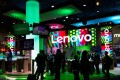 People visit the stand of Lenovo during the Mobile World Congress on the third day of the MWC in Barcelona, on March 1, 2017. Photo: AFP