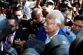 Scandal-tainted former prime minister Najib Razak is met by a media scrum as he arrives to give a statement to the Malaysian Anti-Corruption Commission, in Putrajaya on May 22. Photo: Reuters