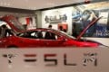 A Tesla Model S in a showroom in Beijing. The car maker said cars that had not been delivered to customers would follow the new prices, regardless of their date of customs clearance. Photo: Reuters