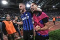 Inter Milan's Skriniar (left) and Inter's Danilo D'Ambrosio celebrate after securing Champions League qualification for their Chinese owners. Photo: EPA