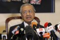 Malaysian Prime Minister Mahathir Mohamad speaks during a press conference in Putrajaya. Mahathir has unveiled a mix of senior politicians, lawyers and a lecturer in his new cabinet after a stunning electoral victory last week. Photo: AP